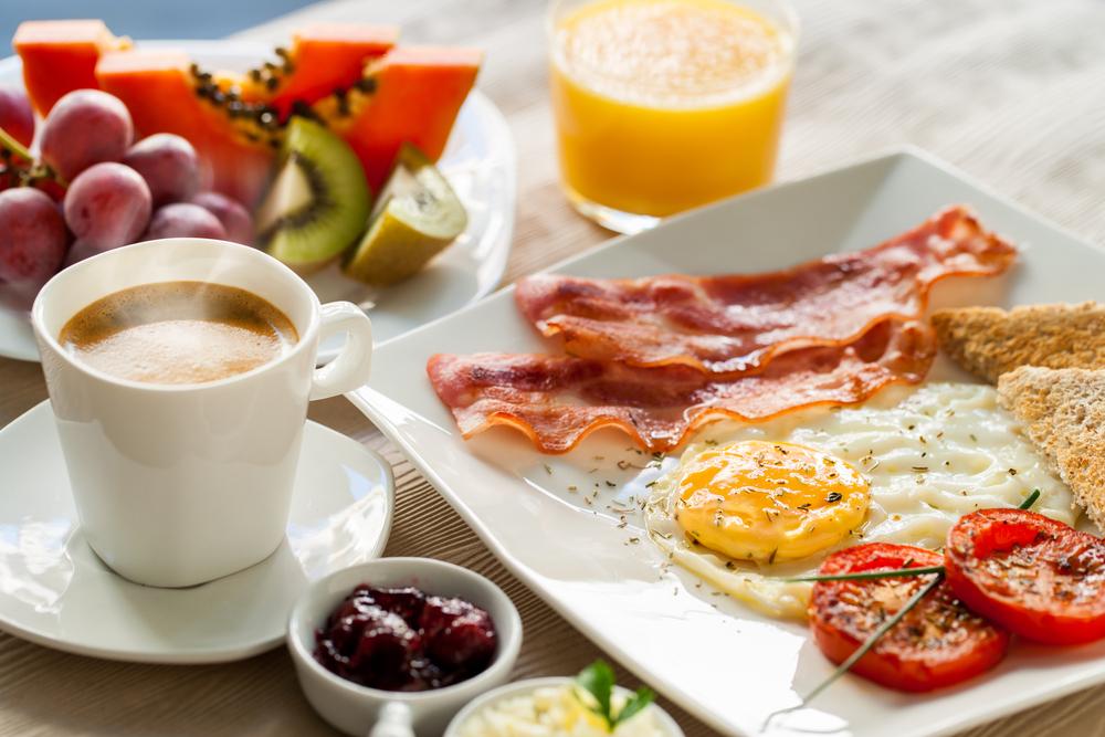 bountiful breakfast of eggs bacon and fruit