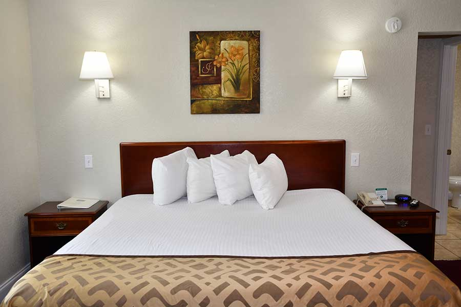 comfortable king bed at downtown Gatlinburg hotel