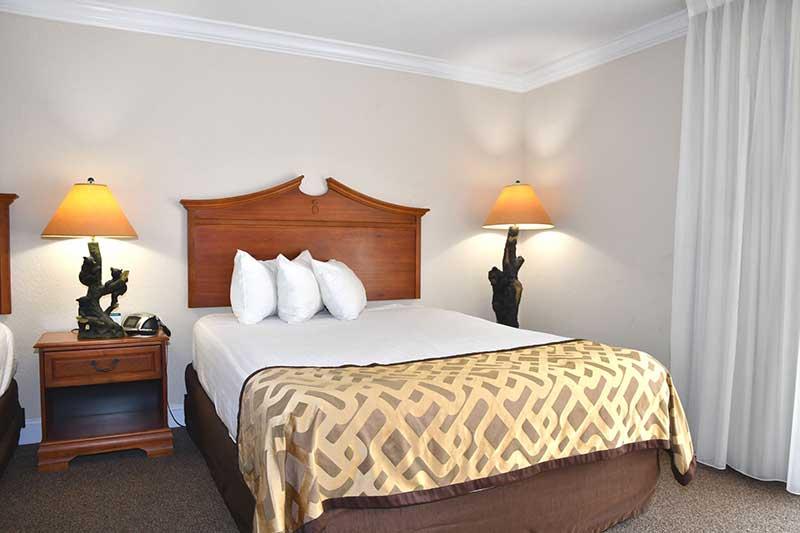 queen bed in Gatlinburg hotel room at Reagan Inn