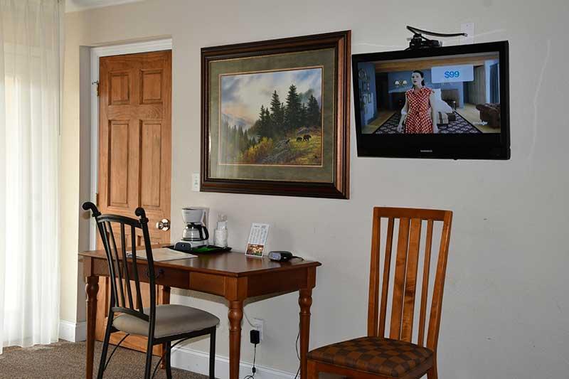 desk and TV in hotel room at Reagan Inn Gatlinburg Tennessee