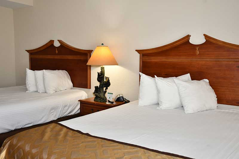 hotel room with two double beds at Reagan Inn