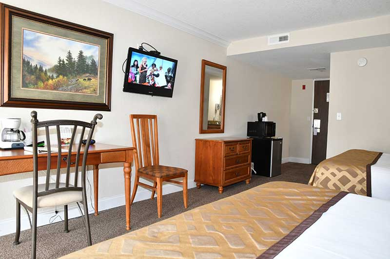 hotel room with two queen beds at Reagan Inn Gatlinburg Tn