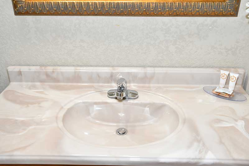 close up of vanity and sink in hotel bathroom