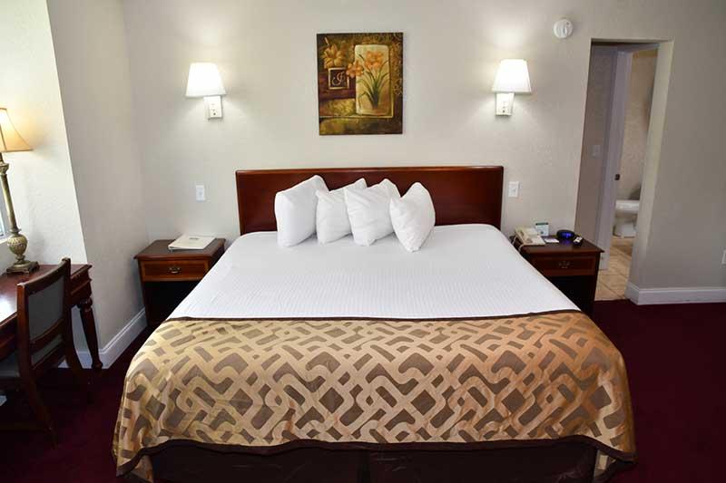 King bed and amenities in hotel room at Reagan Inn in Gatlinburg