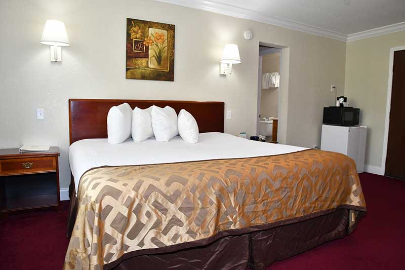 hotel room with king bed at Reagan Inn