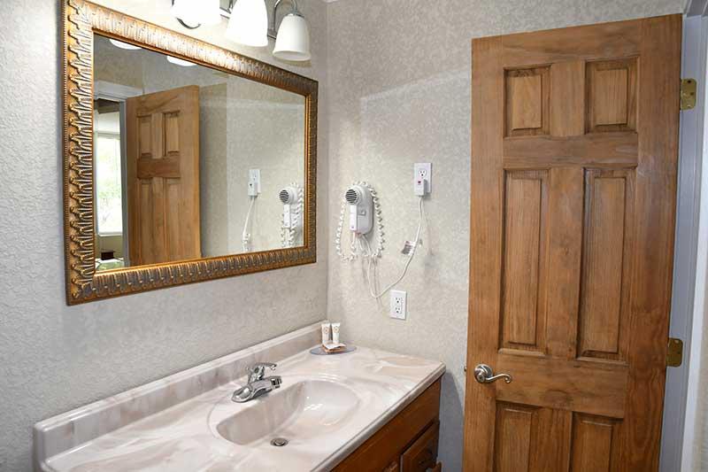 sink and vanity in hotel room at Reagan Inn Gatlinburg Tn
